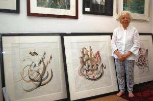Sharifah Zuriah Aljeffri with some of her calligraphy works.